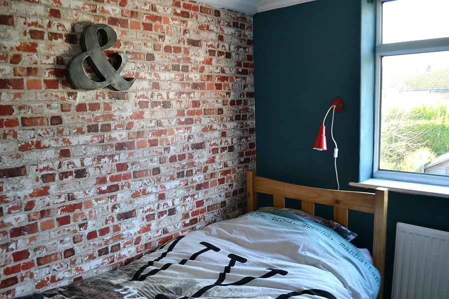 The urban loft look in a teen bedroom tidy away today - Brick wallpaper bedroom design ...