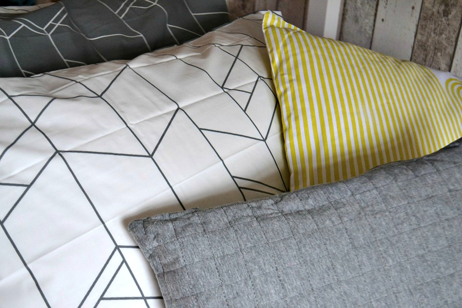 grey and lemon bedding