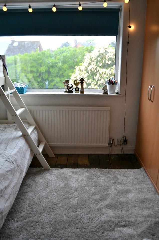 Grey rug boys room